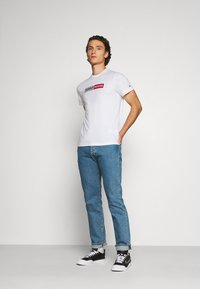 Tommy Jeans - METALLIC GRAPHIC TEE - Print T-shirt - white - 1