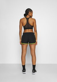 adidas Performance - M20 SHORT - Sports shorts - black/acid yellow - 2