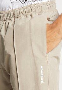 Woodbird - HANSI TRACK PANT - Pantalon classique - sand - 4
