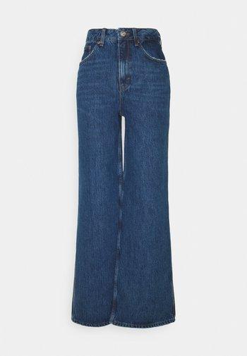 PUDDLE - Flared Jeans - mid vintage