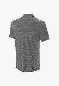 Wilson - TRAINING POLO - Sports shirt - schwarz / weiss (910) - 1