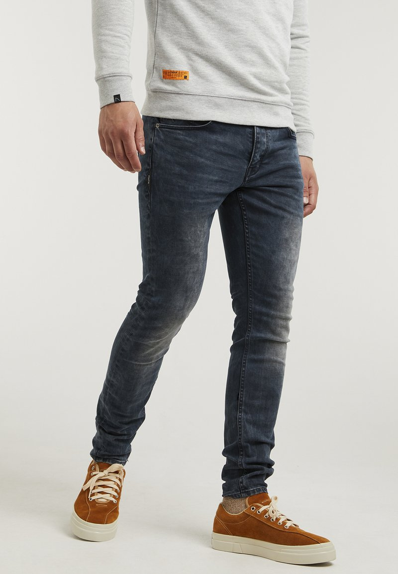 CHASIN' - NEW RAVEN - Slim fit jeans - dark blue