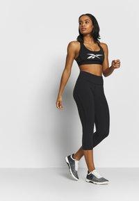Reebok - LUX 3/4 - 3/4 sports trousers - black - 1