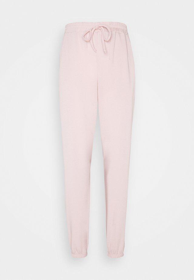JOGGER - Tracksuit bottoms - pink