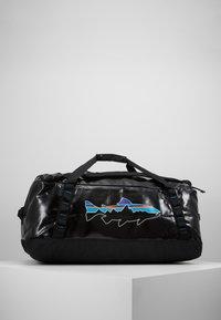 Patagonia - BLACK HOLE DUFFEL 55L UNISEX - Sports bag - black - 2