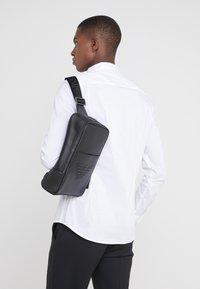 Emporio Armani - BODYPACK - Across body bag - black - 1