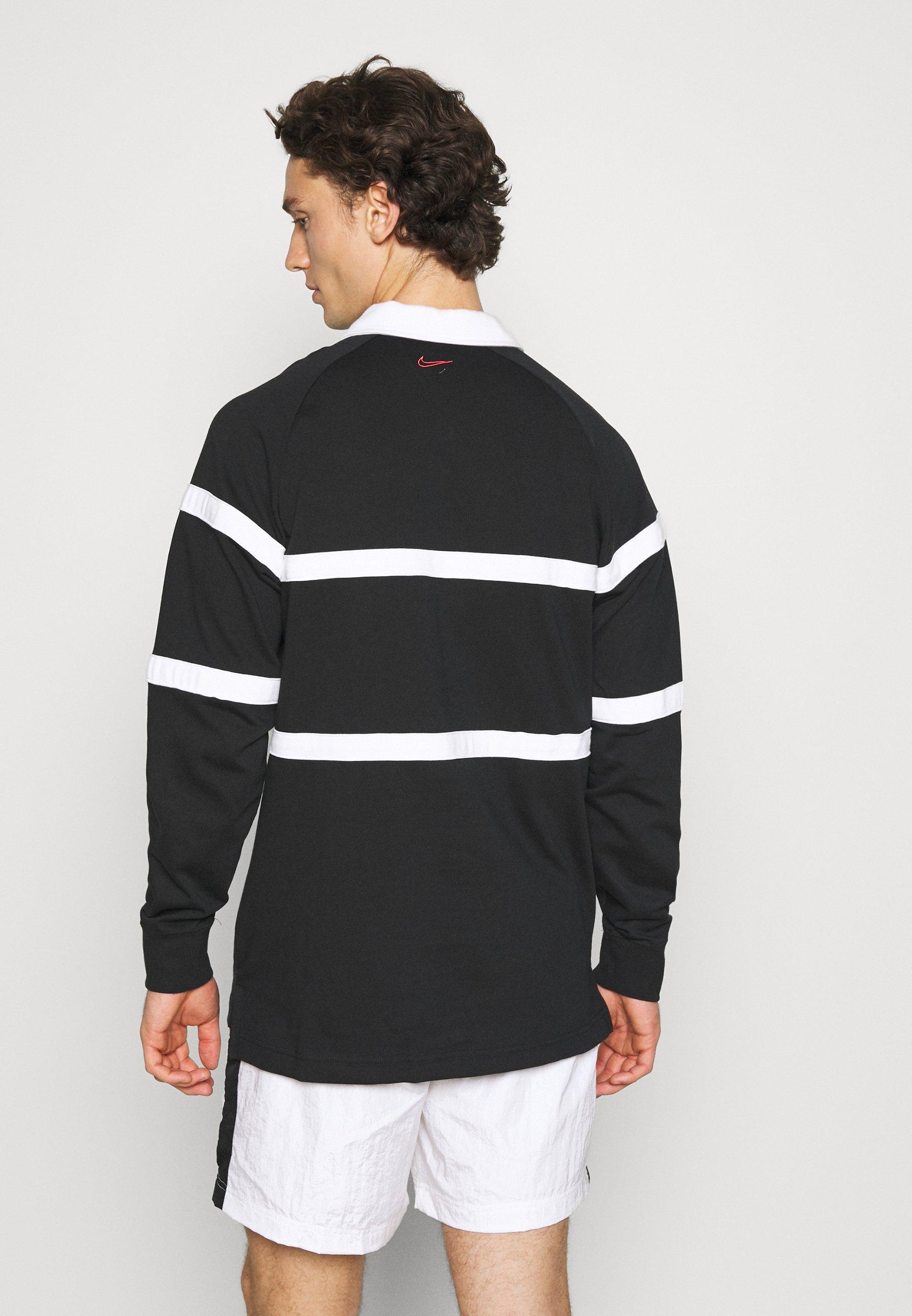 Nike Sportswear RUGBY - Polo shirt - black/white/green tTMYS