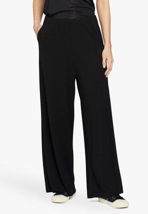 PIRI - Trousers - black