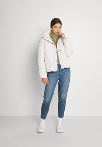 Levi's® - HIGH WAISTED MOM JEAN - Jeans Tapered Fit - eco blue - 1