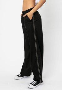 Religion - SUNRISE  - Trousers - jet black - 3