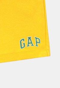 GAP - BOY LOGO  - Tracksuit bottoms - bright lemon meringue - 2