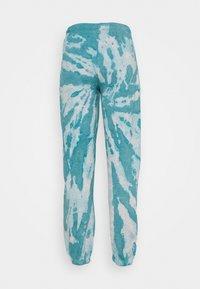 NEW girl ORDER - TIE DYE ETCHED GRAPHIC JOGGER - Teplákové kalhoty - dark blue - 1