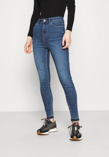 CARRIE - Jeans Skinny Fit - blue denim