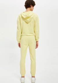 DeFacto Fit - Tracksuit bottoms - yellow - 2