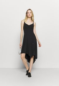 Bloch - ASYMMETRICAL HEM TANK DRESS - Jurken - black - 1