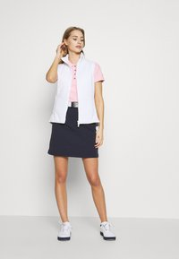 Calvin Klein Golf - PERFORMANCE - Polo shirt - pale pink - 1