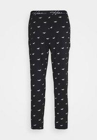Hollister Co. - LOUNGE BOTTOM JOGGERS - Pyjama bottoms - black - 8