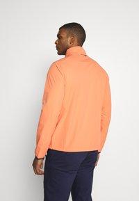 Polo Ralph Lauren Golf - HOOD ANORAK JACKET - Waterproof jacket - true orange - 3