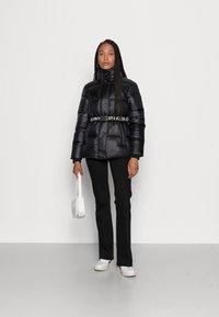 Calvin Klein Jeans - LOGO BELT WAISTED SHORT PUFFER - Winter jacket -  black - 1