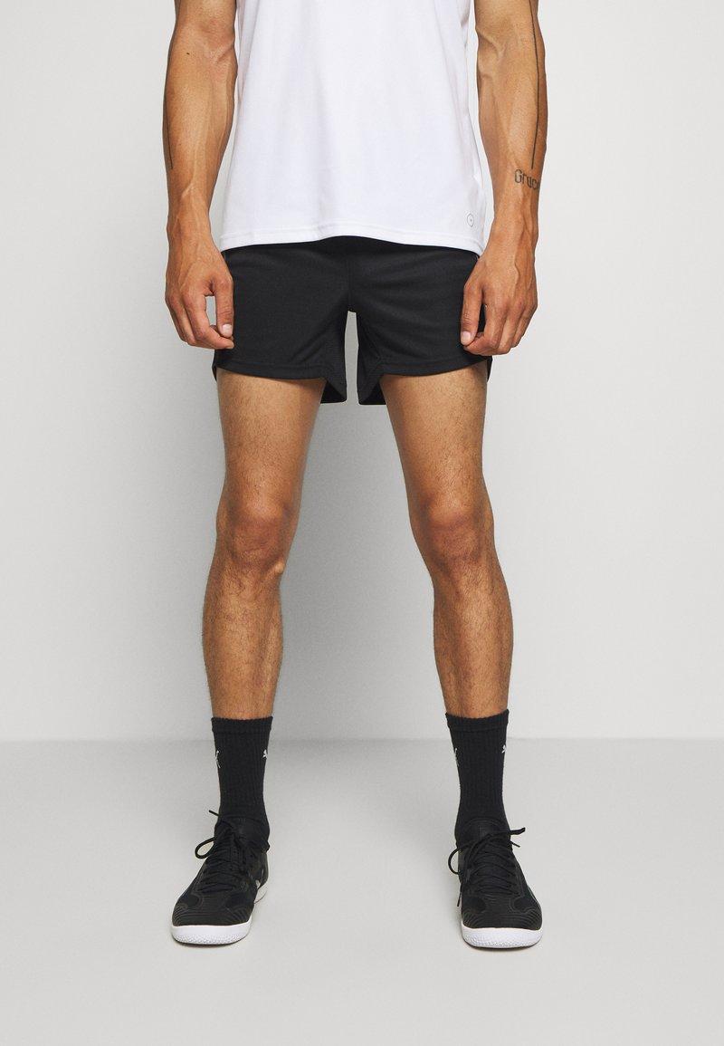 Puma - Sports shorts - black/asphalt