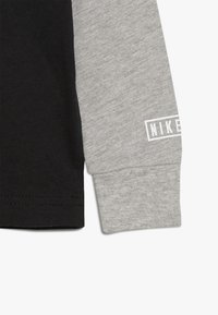 Nike Sportswear - AIR RAGLAN - Bluzka z długim rękawem - black - 4