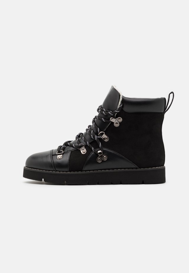 TREKKING BOOTS - Lace-up ankle boots - black