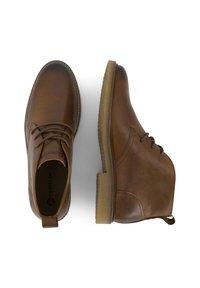Travelin - Lace-up ankle boots - cognac - 2