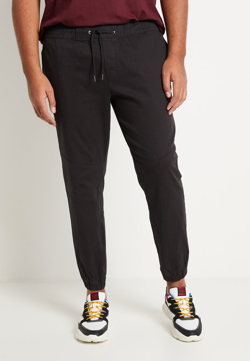 Jack & Jones - JJIVEGA JJJOGGER - Trousers - black