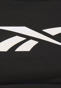 Reebok - LUX SKINNY STRAP - Brassières de sport à maintien normal - black - 6