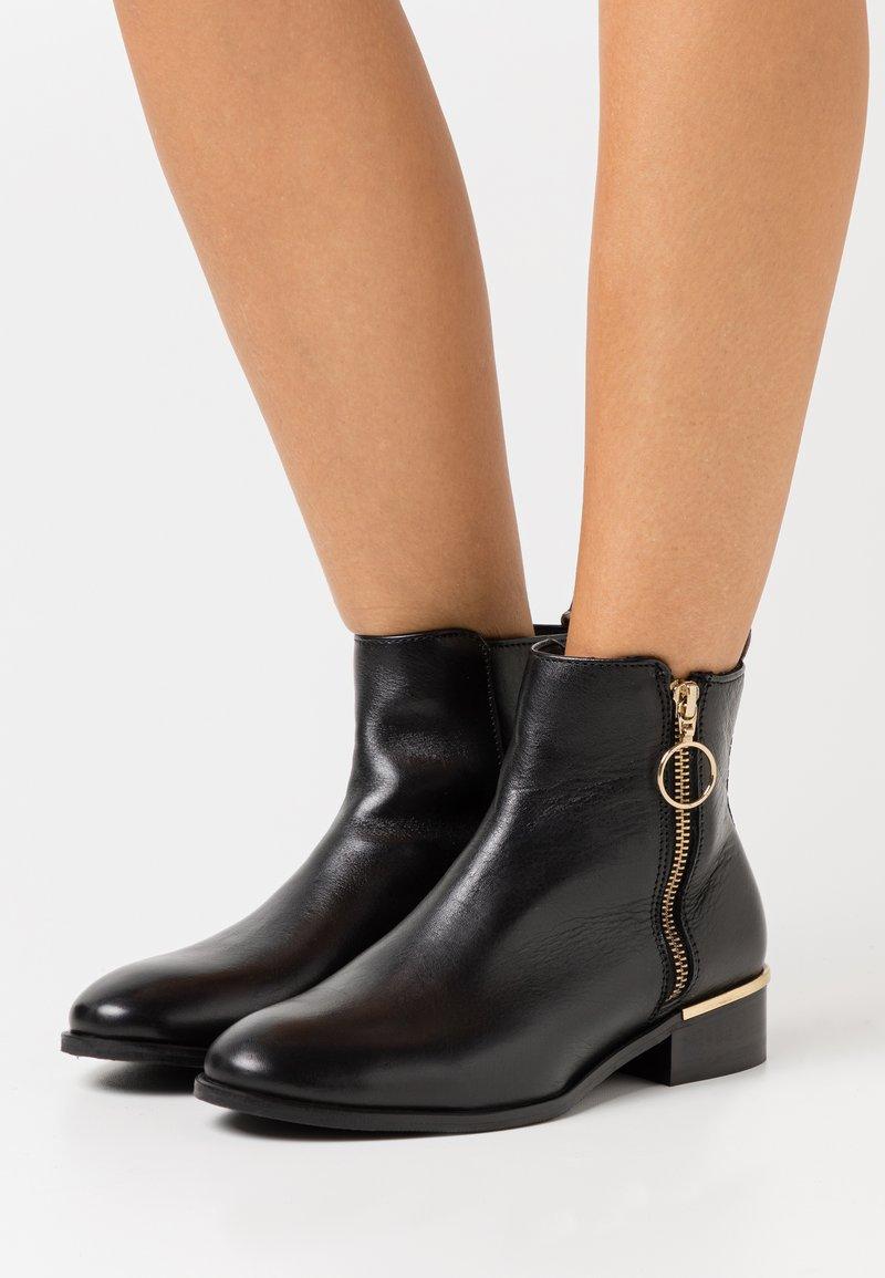 Copenhagen Shoes - FEVER - Classic ankle boots - black