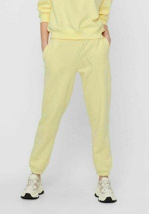 Tracksuit bottoms - pastel yellow