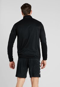 Hummel - CORE ZIP - Langærmede T-shirts - black - 2