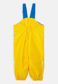 Finkid - PULLEA UNISEX - Rain trousers - yellow - 1