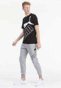 Puma - T-shirt con stampa - black - 1