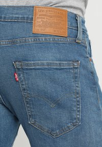 Levi's® - 512 SLIM TAPER  - Slim fit jeans - lightblue denim - 5