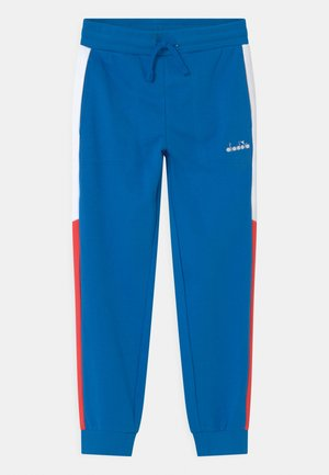 CUFF CLUB UNISEX - Tracksuit bottoms - micro blue