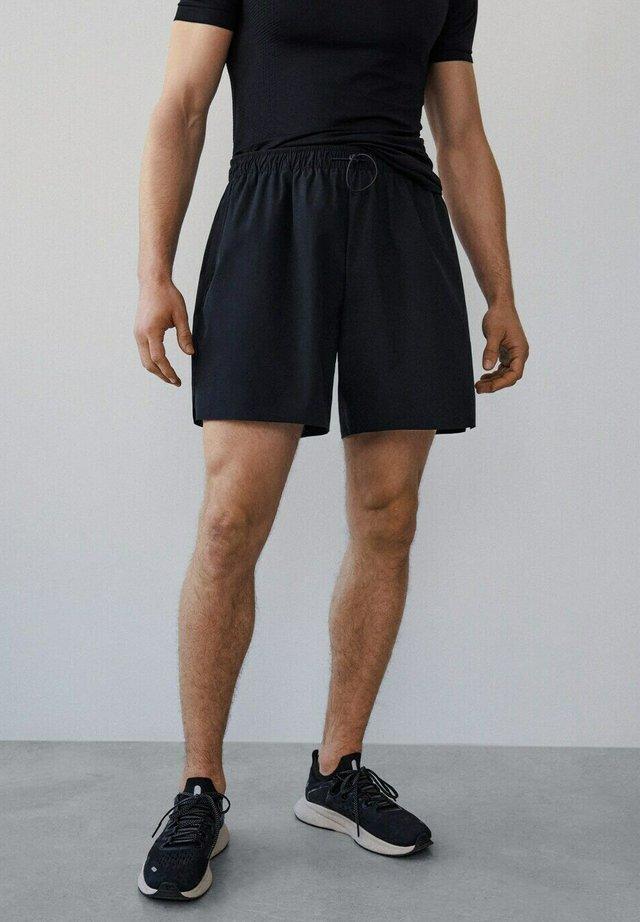 BOGATELL I - Shorts - black