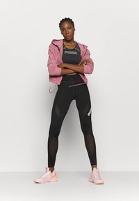 Puma - EVOSTRIPE EVOKNIT CROP - Sports shirt - black - 1