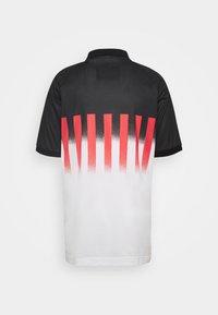 Nike Sportswear - RE ISSUE - Polo - ember glow/black - 1