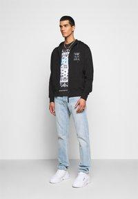 Versace Jeans Couture - FELPA - Zip-up sweatshirt - nero - 1