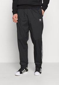adidas Originals - ADICOLOR 3D TREFOIL 3-STRIPES TRACK PANTS - Tracksuit bottoms - black - 0