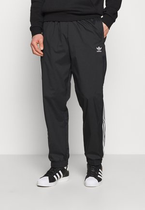 ADICOLOR 3D TREFOIL 3-STRIPES TRACK PANTS - Verryttelyhousut - black
