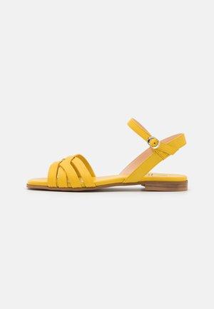 Sandaalit nilkkaremmillä - ceylon yellow
