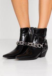 Calvin Klein - PALMMA - Cowboy/biker ankle boot - black - 0