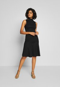 Lost Ink - SLEEVELESS FISHTAIL BODYCON DRESS - Jersey dress - black - 1