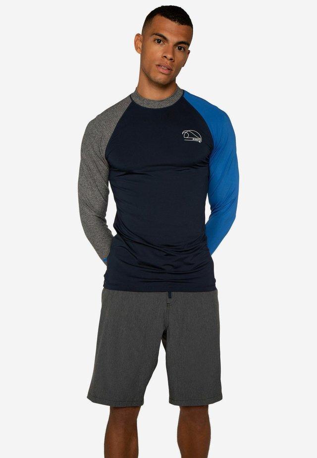 RADWELL - Rash vest - ground blue