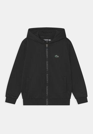 TAPERED ZIP UNISEX - Sportovní bunda - black