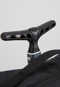 Osprey - CARRY ON  - Wheeled suitcase - black - 8