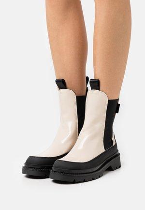 PREPNOVO - Platform ankle boots - putty cream/black