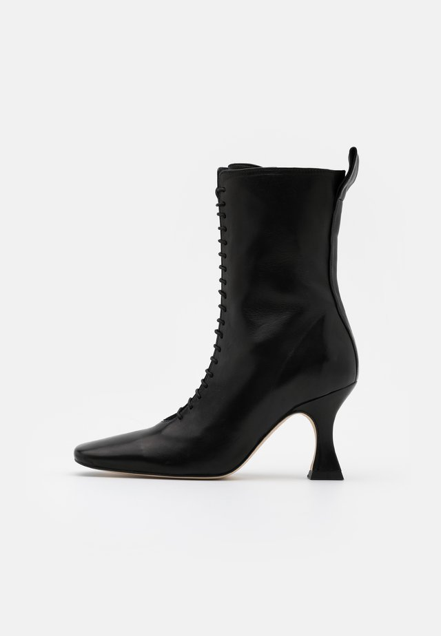 YANA - Lace-up ankle boots - black